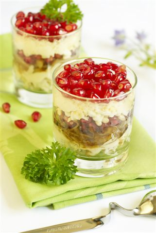 mayonnaise salad with fried onions chicken eggs and pomegranate